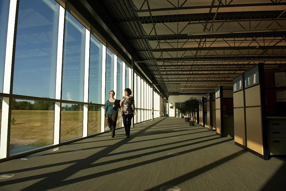 Engineers walking inside RTDS Technologies headquarters in Winnipeg