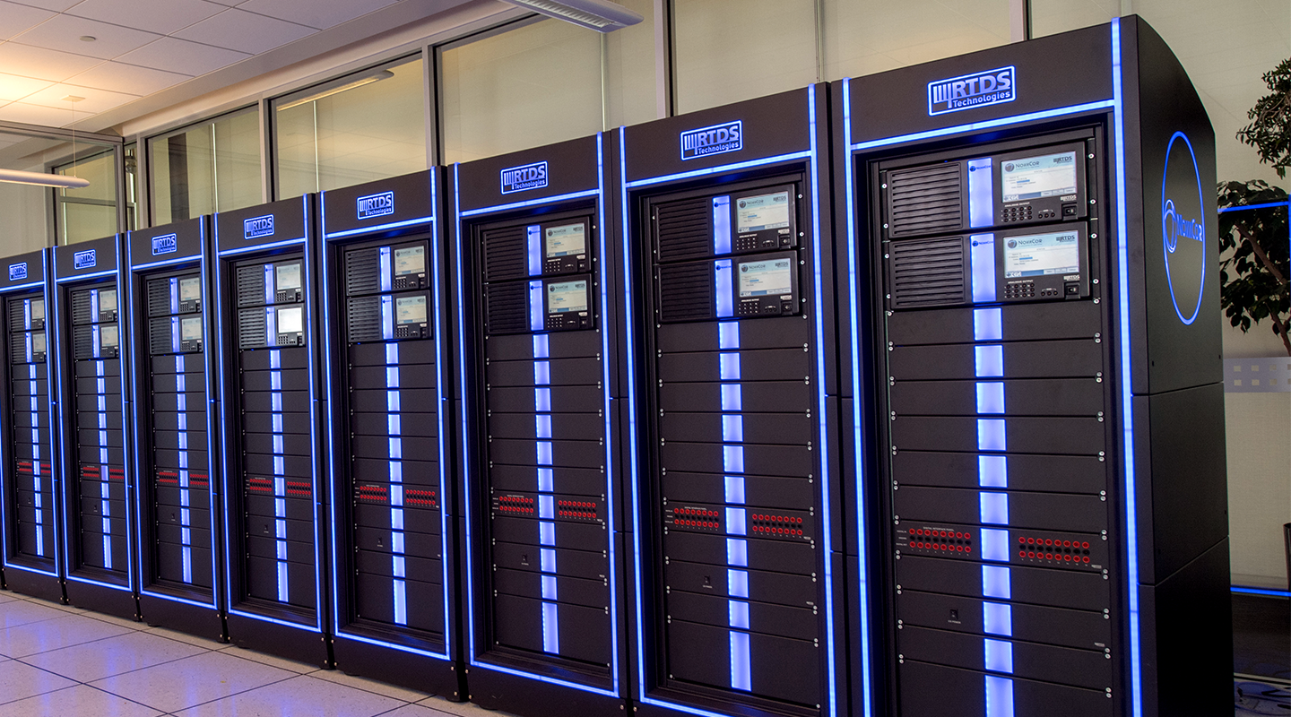 RTDS simulator systems stand stacked side by side in a lab