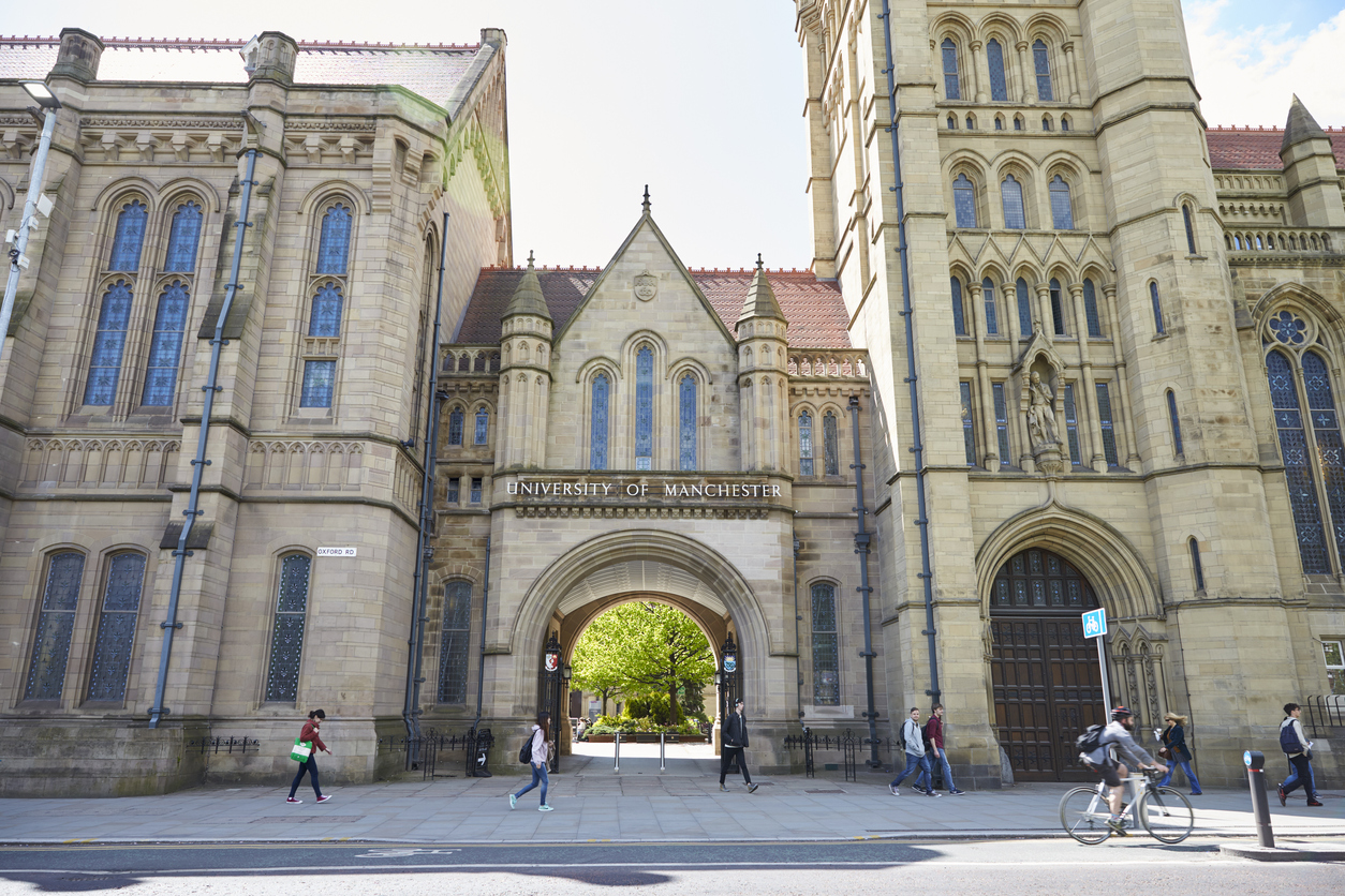 Students stand in front of University of Manchester