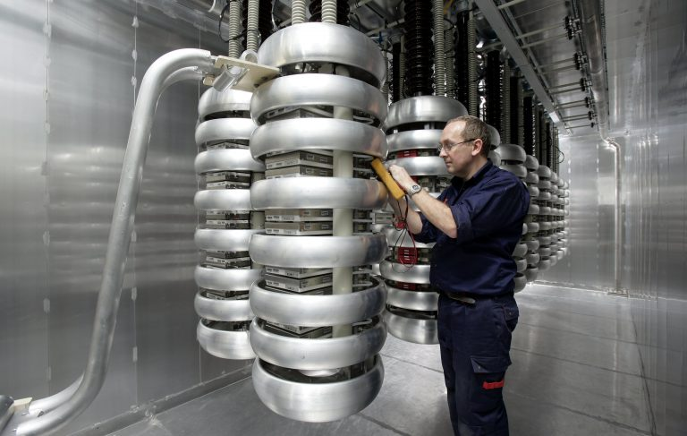 engineer inspecting valve